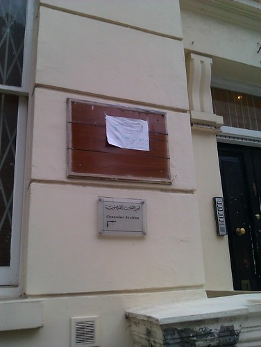 Libyan embassy plaque with a drenched paper above