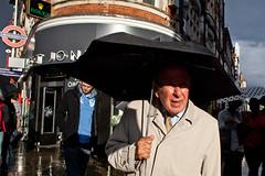 Hold tight (Gary Kinsman) Tags: oxfordstreet w1 london canoneos5dmarkii canon5dmkii canon28mmf18 candid streetphotography streetlife umbrella sun light holdtight old elderly man suit raincoat portrait 2011 people person