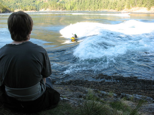 Watching kayakers do tricks