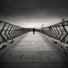 Toll Collector (~ superboo ~ [busy busy]) Tags: sanfrancisco morning shadow blur metal dark ominous overcast toll figure railing collector angled tiltshift pier14
