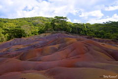 Seven Coloured Earths of Chamarel (Benjamin von Tilly Kistner) Tags: africa travel blue red sky panorama brown holiday color green tourism nature yellow rock canon photography eos canal photo colorful niceshot purple african natur dream violet surreal sigma bluesky soil minerals afrika mauritius terra farbe canoneos surrealistic farbig attraction tourismus vulkan erde vulcanic gestein geologie chamarel mineralien polfilter touristik polarisingfilter geologicalformation polarisationsfilter sigma175028 vulkangestein sigma1750 canoneos60d eos60d mygearandme mygearandmepremium mygearandmebronze ringexcellence musictomyeyeslevel1 ferraliticsoil