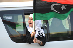 A supporter of the Libyan rebels celebrates in Tripoli on 1 September, shortly after Gaddafi's forces were defeated in the capital.  Image from Ammar Abd Rabbo's photostream