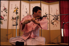 Flute Player at P'ansori Performance, Seattle (Washington State Folk Arts) Tags: flutes musicalinstruments storytellers narrators verbalartsandliterature koreanpansoriperformers