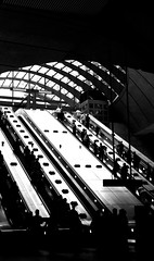 Canary Wharf Station (ttamzz) Tags: camera trip family blue summer bw white holiday playing canada black london westminster sunglasses station closeup stairs train towerbridge londonbridge underground subway square landscape tickets pier boat amazing day view sony tube sunny wharf a200 blacknwhite canarywharf picnik messingabout travelcard esclators expirment canadasq