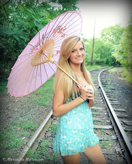 The girl with the pink umbrella (Alexandra Hollenczer) Tags: portrait people woman girl beauty smile vintage happy model traintracks young teenager umbrellas railroads pinkumbrella floarl alexandrahollenczer hollenczer