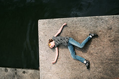 Ophelia's mishap (the aurelian) Tags: bridge playing silly film water girl analog outdoors canal iso200 joke rangefinder 200asa dandelion vintagecamera fujifilm drama yashica hamlet lynx ophelia pretending williamshakespeare darkhumor blackhumor superia200 14e yashinon teenageangst manualsettings nolightmeter yashicalynx14 newscan literarure playreenactment guesstimatedexposure reenactingabook  theaurelian