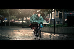 Sport Woman (Jeff Krol) Tags: street city storm holland reflection netherlands dutch face sunshine rain bike bicycle sport canon eos shiny flat wind nederland streetphotography cape pedals f2 cinematic hoogeveen 135mm 135l sportive sportbag 60d ef135mmf2lusm jeffkrol