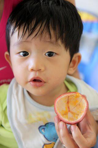 Ethan_eatingpassionfruit