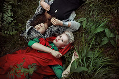 Whispering Grass (Alexander Kuzmin) Tags: above wood red portrait haircut green girl fashion fairytale forest hair scary couple wolf alone dress darkness availablelight innocent riding short stare hood rest cloak gaze glance redridinghood lay alexanderkuzmin kuzmin