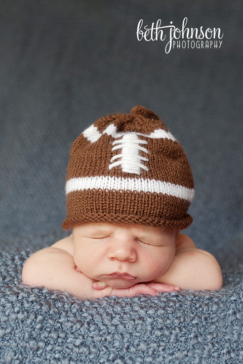 newborn baby boy in football hat tallahassee photographer