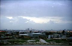 unrecognized village and beer sheva (helga tawil souri) Tags: 2003 israel desert palestine negev beersheva bedouin naqab israelpalestine palestineisrael unrecognizedvillage bersheva birsaba