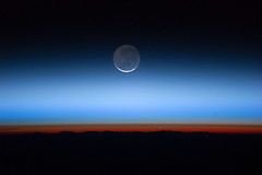 Moon Over Earth (NASA, International Space Station, 07/31/11) [Explored] (NASA's Marshall Space Flight Center) Tags: moon station clouds earth atmosphere limb tropopause troposphere noctilucent stationscience iss028e020072