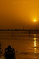 On the river' I stand alone. (Tanzeel Rehman) Tags: morning bridge pakistan light sun water river golden boat stand nikon alone general ravi punjab lahore d90 sahab 18135mm tanzeel
