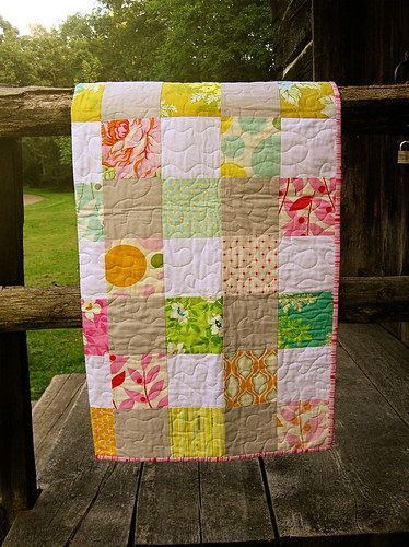 nicey jane baby quilt hanging on the rail