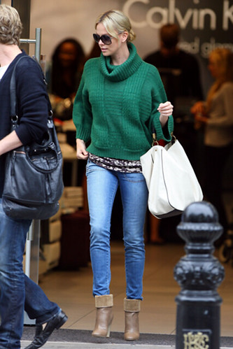 charlizetheron wears green knitted sweater