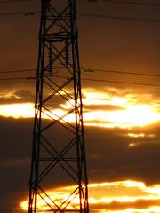 Pylon # 10 (David Alexander Beedie) Tags: sunset rooftops powerlines pylons