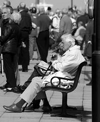 Waiting (* RICHARD M) Tags: street monochrome mono blackwhite candid newquay benches queenmary2 crowds pierhead liverpoolmerseyside