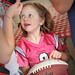 A young Wolfpack fan proudly shows off the autograph she just got from players at Meet the Pack Day (And yes, that is a pink jersey).