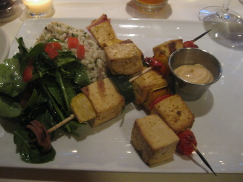 Grilled tofu and veggie skewers with spicy dipping sauce, cous cous and arugula salads.