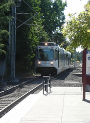 """A Bombardier-BN """"Type 1"""" car approaches the Hillsboro Airport & Fairgrounds station"""