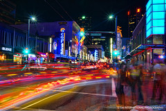 Granville Street on Overdose (TIA International Photography) Tags: life road street city blue light red summer people urban orange canada motion black blur color colour reflection building green cars coffee colors yellow youth bar club night vancouver mall tia restaurant rainbow pub colorful stream downtown neon chaos colours nightscape purple traffic granville vibrant crowd cyan violet trails vivid august nelson social columbia vehicles trail strip drugs pedestrians british intersection streams nightlife autos curve blenz avenue overdose tosinarasi tiascapes tiainternationalphotography