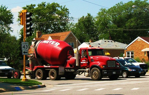 A red Mack cement mixer truck from Meyer Materials Company.  Niles Illinois USA.  August 2011. by Eddie from Chicago