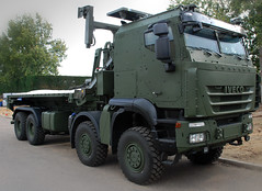 IVECO -8x8 fitted with a Marshall flatrack and Cargotec hookloader