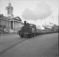 September 12, 1962 (National Library of Ireland on The Commons) Tags: church cork engine trains goods september cobblestones 1960s cobbles esso 1962 choochoo steamtrain wagons handbell shipstreet gswr nationallibraryofireland lowerglanmireroad greatsouthernwesternrailway jamespodea crosscityrailway unitygarage corkcityrailwayco clydecutting westcorkline odeaphotographiccollection