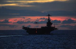 An F/A-18 Hornet lands aboard USS John C. Stennis