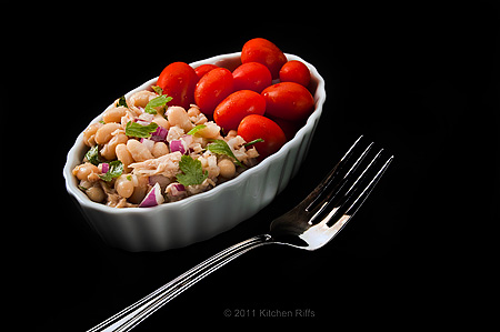 White Bean and Tuna Salad in oblong ramekin with cherry tomatoes