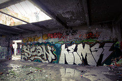 ZOMBIE LIFE (ALL CHROME) Tags: old blackandwhite snow streetart film canon graffiti explorer banksy scan bitch drugs guns spraypaint sucks graff dicks obama dubstep cocaine kemer kem kush bipolardisorder larks fedral bailout allchrome pnoid kem5 kems kemr beiber slumdogmillionaire graffiti2009