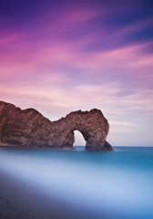 Durdle Door Sunset (Explored #46 on 14th August 2011) (paulwynn-mackenzie.co.uk) Tags: door longexposure blue sunset sea bw mist seascape color colour beach water rock clouds landscape photography coast movement exposure purple cove sony tripod calming a33 filter cast dorset nd alpha jurassic slt worldheritage lulworth durdle durdledoor movingclouds jurassiccoast digitalcameraclub neutraldensity nd1000 nd110 bw110 colorphotoaward worldheritagesight slta33 flickrstruereflection1