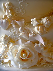 Cherubs, hearts and roses (nice icing) Tags: wedding roses cake hearts gold carlton towers cream pearls cherub icing madhatter