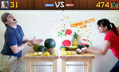 33/52 - Kriegs vs. Minty (kriegs) Tags: selfportrait fruit lemon funny girlfriend coconut watermelon pineapple grapes duel parody vs versus 52weeks 30mmf14 fruitninja 52weeksofmintykriegs comboblitz