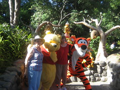 Grandma and her friend Jenny pose with Pooh and Tigger