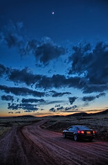 Driving into the Night (Fort Photo) Tags: road sunset sky moon nature landscape vanishingpoint nikon colorado tl path co dirtroad bluehour acura hdr pathway larimer twotrack clff larimiefoothills