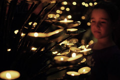 Faith or the March of the Little Candles (josemanuelerre) Tags: light shadow italy luz church girl look fire florence italia candle little bokeh faith religion llama iglesia sombra nia flame glaze desenfoque florencia mirar stare firenze fe vela pequeo religin fiego