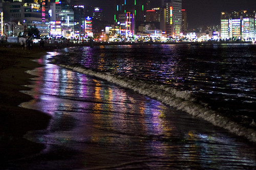 Pusan at Night with Wet Glowing Sand