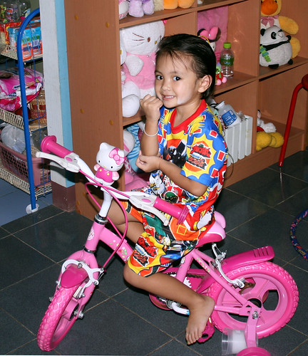 Nong Ja with Power Rangers and Bike