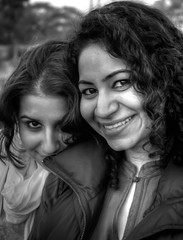 Contrasting Expressions (Impersonation) Tags: girls portrait nikon d70 d70s 2008 pallavi ipsita newyearday sohna