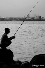 Patiently waiting for his prey #3. (Reggie Wan) Tags: seascape man silhouette fishing singapore asia southeastasia punggolbeach reggiewan sonya850 sonyalpha850 gettyimagessingaporeq1