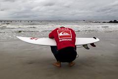 A Prayer before Riding (Timothy Schenck) Tags: nikon surf surfing longisland longbeach quiksilver kellyslater d300 nikond300 quiksilverprony