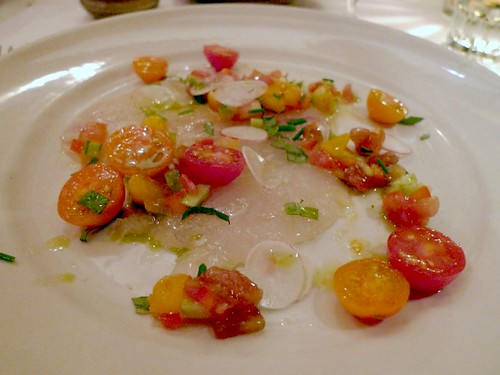 Local halibut crudo with tomato confetti and basil oil