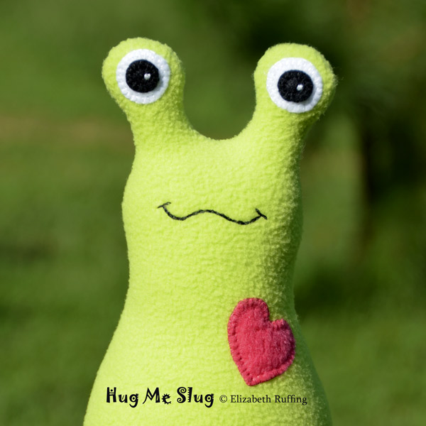 Bright light green fleece Hug Me Slug original art toy by Elizabeth Ruffing
