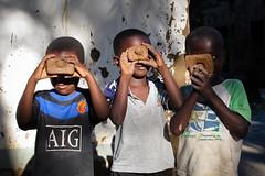 Boys with clay cameras (Lil [Kristen Elsby]) Tags: africa camera travel boy portrait boys topf25 children tanzania island photography village child toycamera getty editorial mafia gettyimages topv7777 travelphotography fakecamera mafiaisland utende canong12 claycamera
