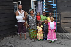 Anne Marie, a Kila Siku Embroiderer, with her family at home, DR Congo (Kila Siku) Tags: poverty africa children volcano support women war belgium linen embroidery goma violence congo humanitarian tailor drc theodore nyiragongo finelinen atelierabc libeco kilasiku