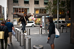 The city is an adventure (sjmgarnier) Tags: street newyorkcity boy people urban woman usa newyork mom kid jump jumping manhattan mother son september adventure sidewalk portfolio posts columbuscircle 8thavenue timewarnercenter youngboy 2011 youngkid colorstreetphotography fromposttopost
