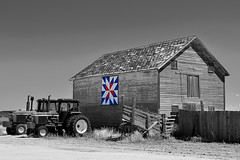 Quilt Barn (wellscenephotography (ON)) Tags: light summer tractor monochrome barn rural mono photo nikon scenery colorado quilt image photograph summertime agriculture selectivecolor fortmorgan 2011 morgancounty 081111 d5100