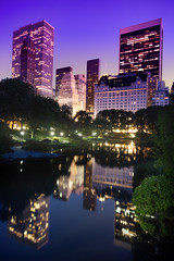 'From The Gapstow Bridge' United States, New York, New York City, Central Park, Central Park Pond, Gapstow Bridge View (WanderingtheWorld (www.ChrisFord.com)) Tags: park plaza new york city nyc travel blue chris trees sky ny reflection water skyline night point photography lights hotel photo blog interesting pond skies glow view path united central scenic picture pic landmark nighttime states cp picturesque interest centralparkpond schoenbohm lostmanproject