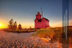 Big Red Lighthouse (Craig - S) Tags: wood light sunset sea usa lighthouse house lake seascape holland beach water dutch grass mi america landscape bay harbor us log sand midwest unitedstates michigan dune shoreline safety lakemichigan greatlakes driftwood american shore transportation americana railing shipping inland beacon channel bigred uppermidwest lakemacatawa hollandharbor allegancounty dutchinfluence